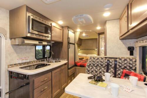 Four Seasons RV Rentals - Class C Medium Motorhome | Kitchen & Dinette