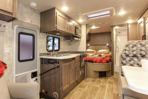 Four Seasons RV Rentals - Class C X-Large Motorhome | Rear Bed
