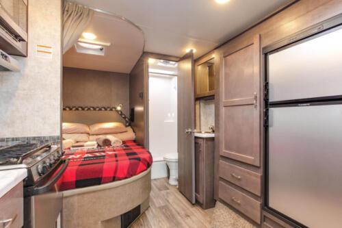 Four Seasons RV Rentals - Class C X-Large Motorhome | Rear Bed & Bathroom